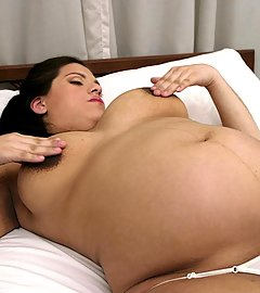 Horny preggo chick Loli masturbates in bed by rubbing her pussy with a huge ribbed dildo live