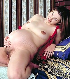 Hot pregnant babe fondling her hairy twat