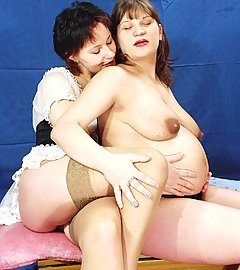 Sexy pregnant model Daisy lures her girl pal into eating out her muff and play with her tits live